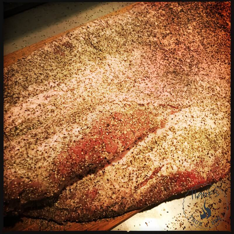 Brisket with rub applied