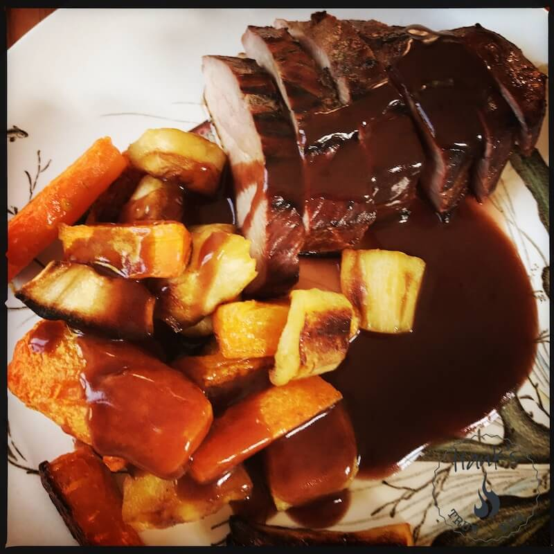 Grilled and smoked duck breasts with oven roasted veggies and a red wine sauce