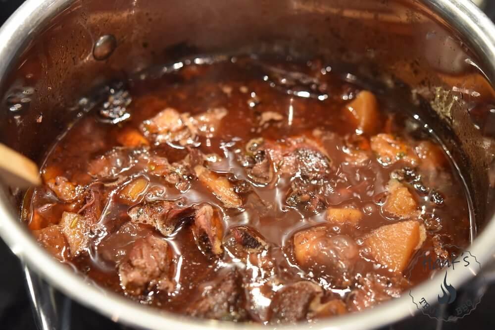 Iberico pork cheeks, simmering.