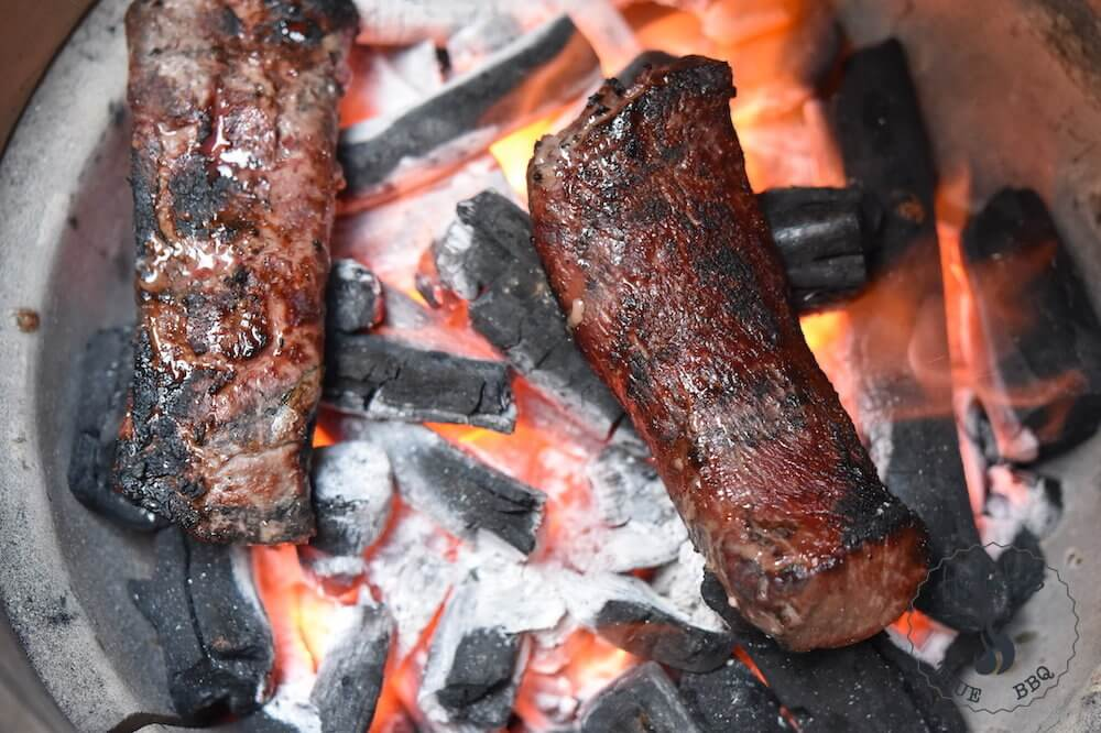 Caveman grilling - meat on the coal bed