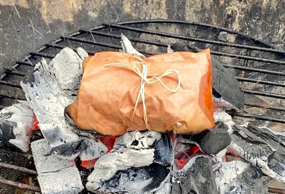Cod in butcher's paper on the grill